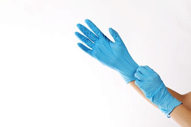 Human wearing glove on white background.