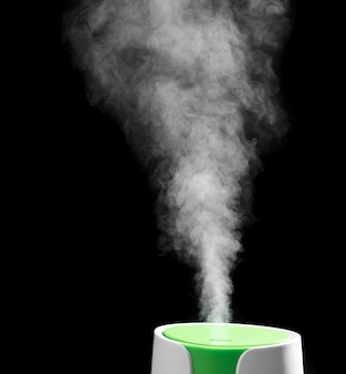 Humidifier in the process of work on a black background