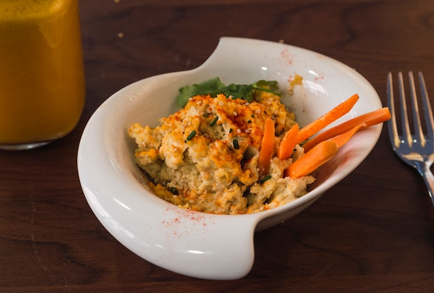 Hummus with carrot and sesame sticks. healthy dish close-up