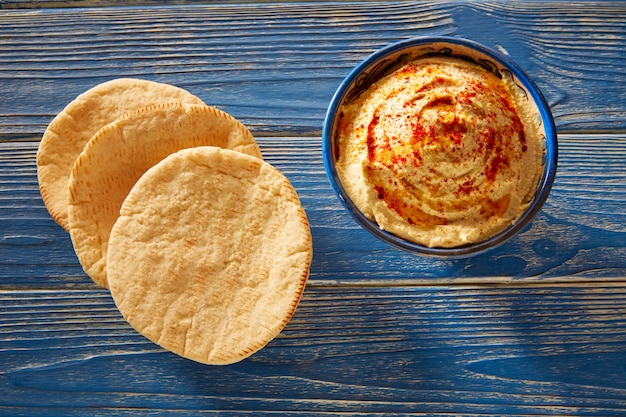 Hummus with pita bread and red pepper powder