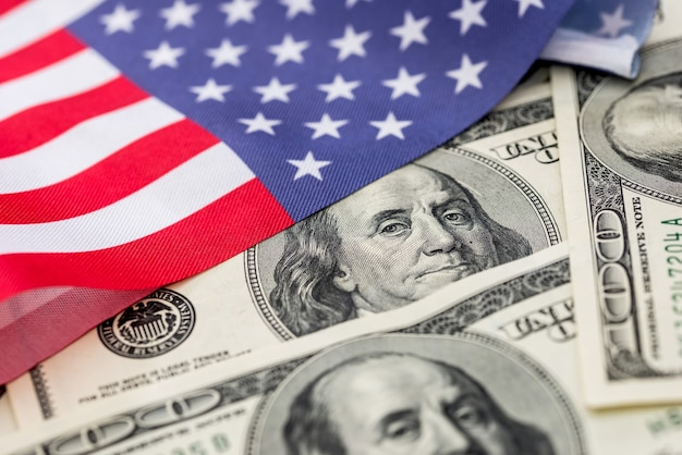 Hundred dollar bill of the american flag close up