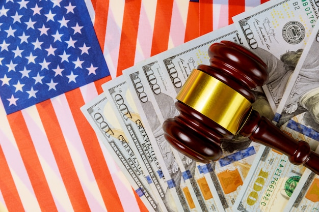 Hundred dollar bills, american flag and gavel