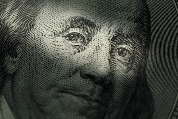 Hundred dollars bill - benjamin franklin. selective focus