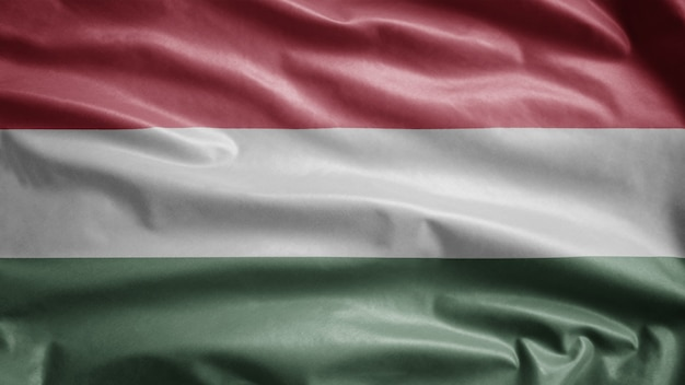 Hungarian flag waving in the wind. close up of hungary banner blowing soft silk