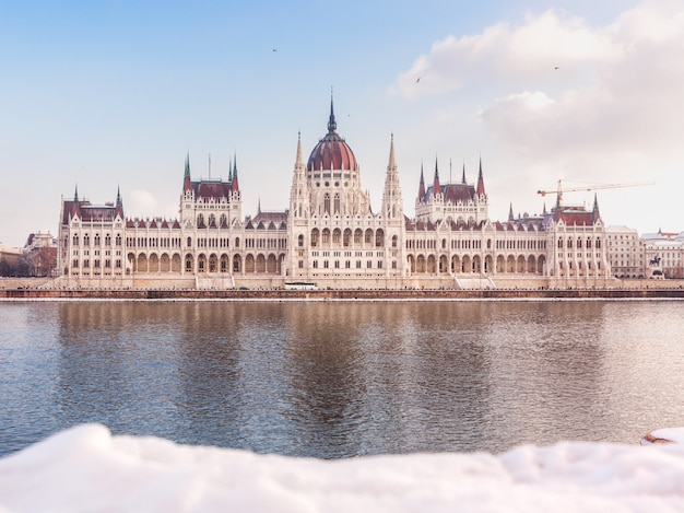 Hungarian parliament building at winter. snow lies on the river bank, budapest, hungary