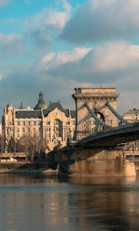 Hungary budapest, chain bridge against the background of the gresham palace, reflected on the water