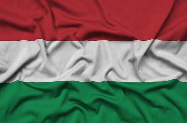 Hungary flag is depicted on a sports cloth fabric with many folds.