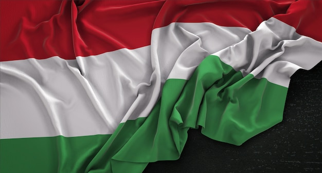 Hungary flag wrinkled on dark background 3d render