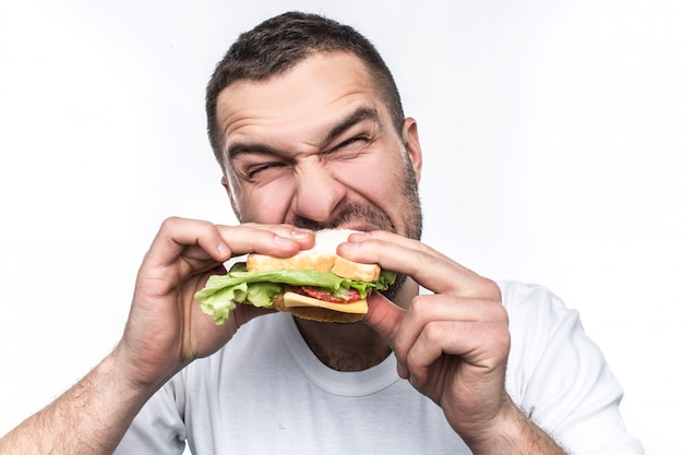 Hungry guy is eating some fast food