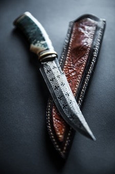 Hunter combat hand made knife isolated on white