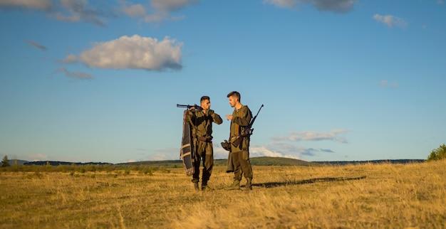 Hunters with shotgun guns on hunting season