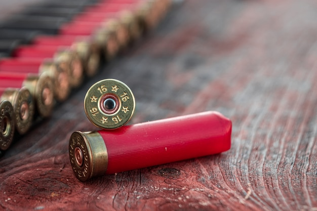 Hunting cartridges in patronage are lying on a wooden table