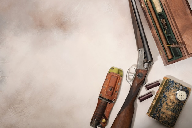 Hunting concept with shotgun, knife and ammunition for hunting.