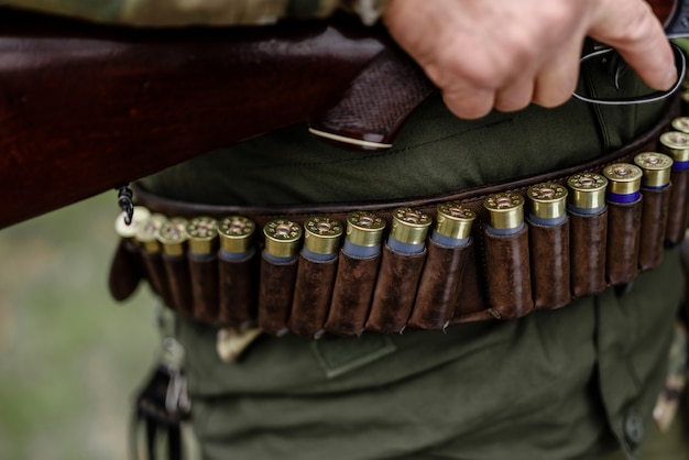 Hunting equipment ammunition cartridges on belt.