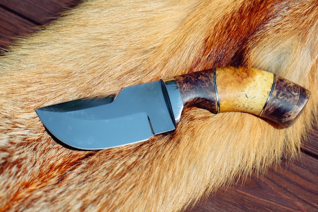 Hunting knife on red fox fur.