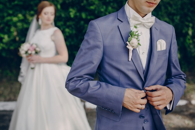 Husband clasping the suit