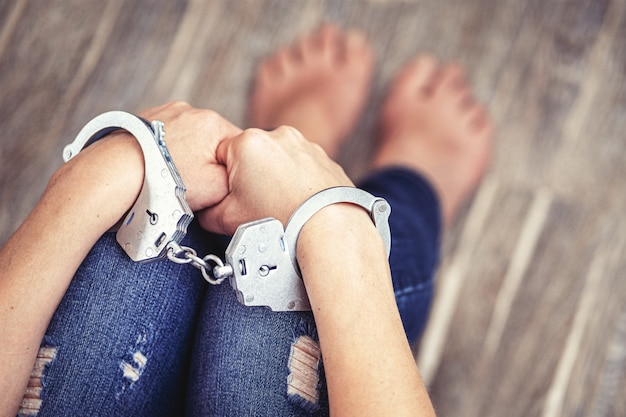 The husband holds his wife in handcuffs