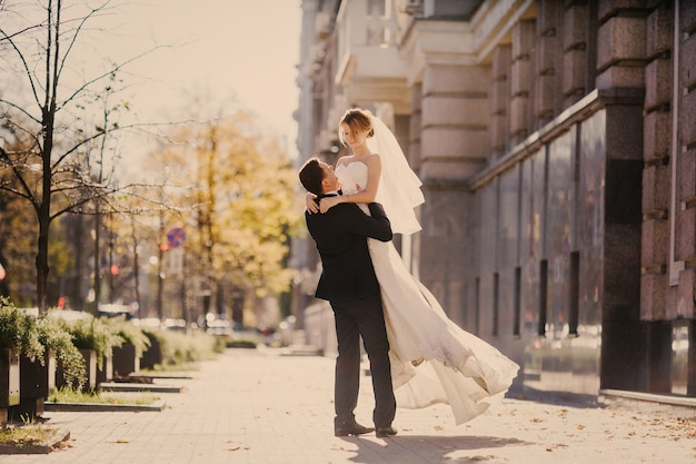 Husband lifting his wife