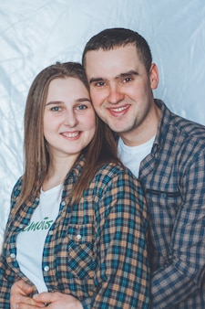 Husband and wife in checkered shirts. happy married couple. family happiness