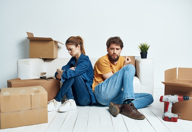Husband and wife moving boxes with things tools repair housewarming