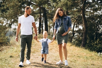Husband with pregnant wife and their son