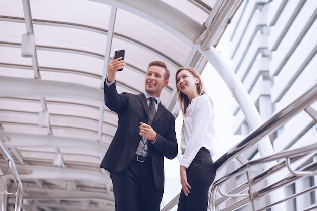 Husbands and wife  use their smartphones to video call