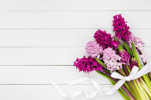 Hyacinth flowers bouquet with white ribbon