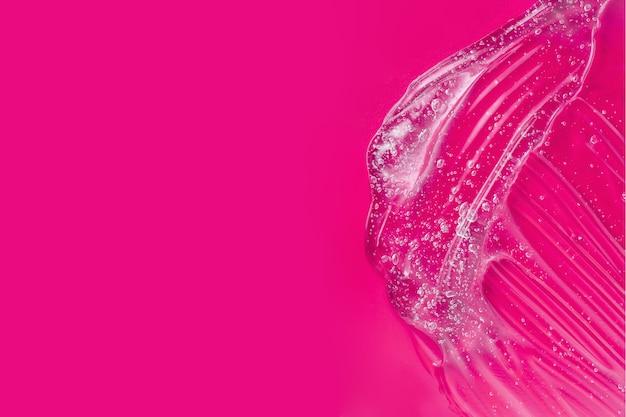 히알루 론산 번짐. 윤활유 샘플. 비타민 보습제. 젤리 질감. 투명한 스킨 케어 제품. 거품과 알로에로 화장품 젤 얼룩. 액체 로션 얼룩. 세럼 젤. 공간 복사