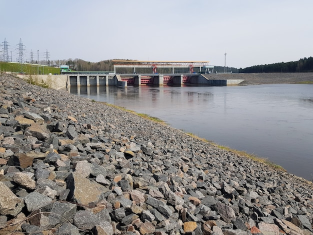 Hydroelectric power station on the river generating electricity from water pressure