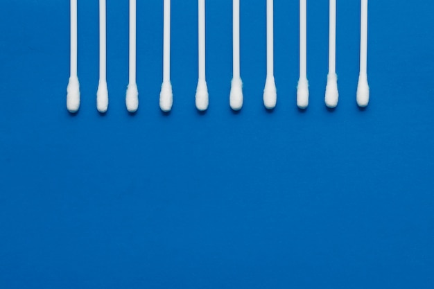 Hygienic, cotton buds on a blue background.