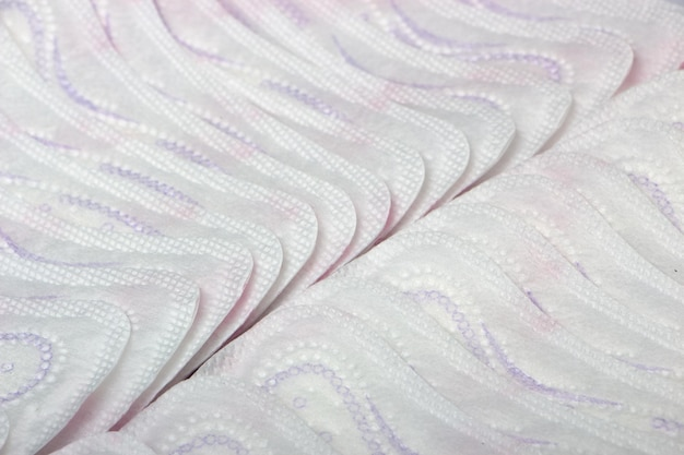 Hygienic daily ultra-thin panty liners on a white background close up