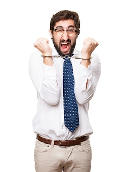 Hysterical businessman with handcuffs