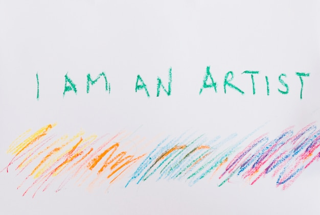 I am an artist' text and colorful crayon stroke on white paper