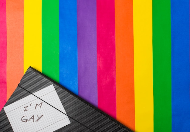 I am gay words on paper against document case on lgbt flag