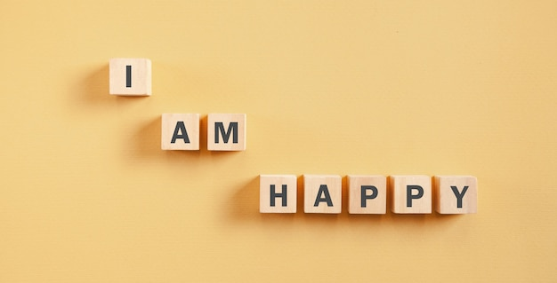 I am happy message on wooden cubes.