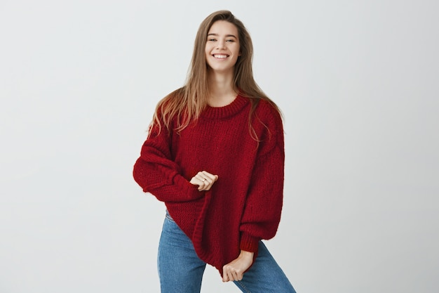 I bought it on sale. emotive carefree woman in stylish outfit looking happy and pleased while posing and smiling , stretching sweater, standing . i received good feedback