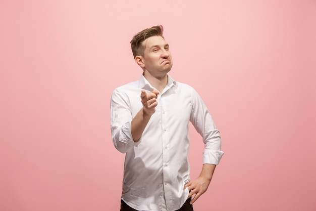 I choose you and order. the smiling business man point you, want you, half length closeup portrait on pink. the human emotions, facial expression concept. front view. trendy colors