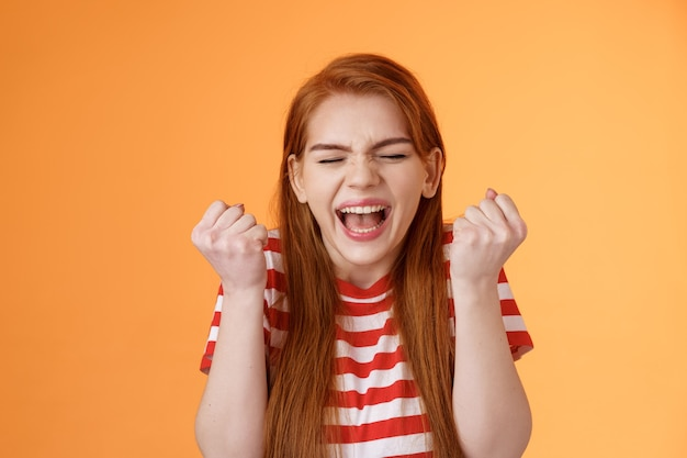 I did it charming lucky determined redhead female achieve success fist pump celebrating close eyes y...