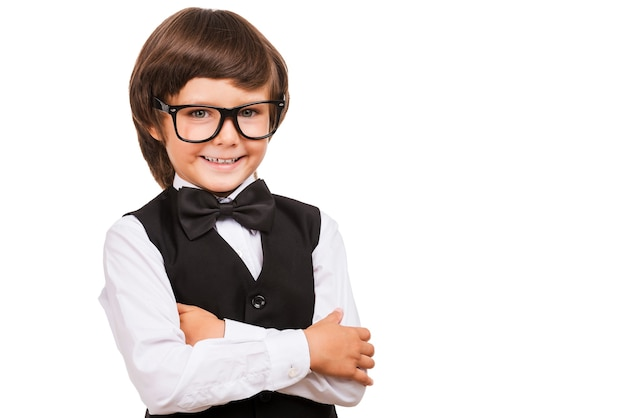 I know a lot of things. portrait of young boy in bow tie looking at camera and smiling while isolated on white