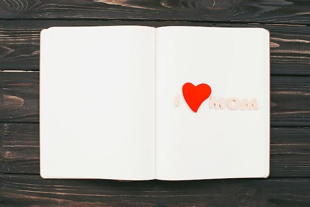 I love mom inscription on blank notebook