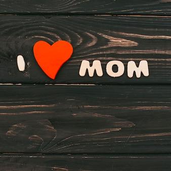 I love mom inscription on table
