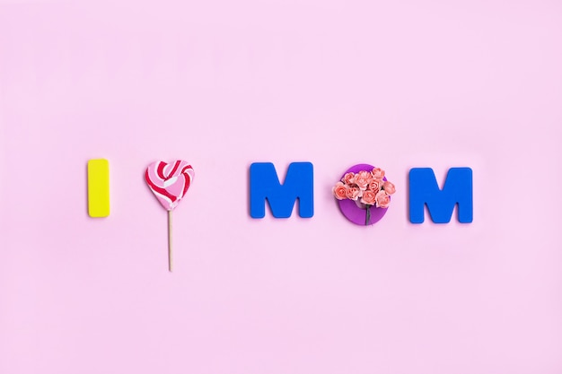 I love mom mothers day message on pink wall.