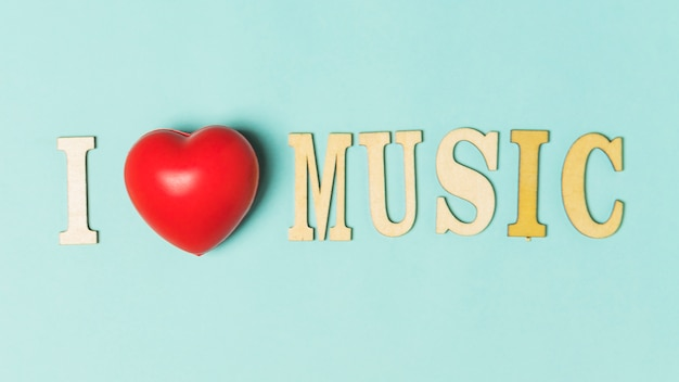 I love music text with red heart on turquoise background