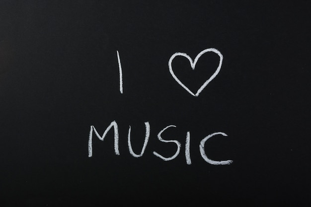 I love music text written with chalk on blackboard