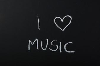 I love music text written with chalk on blackboard