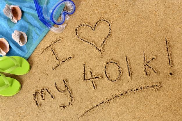 나는 401k를 좋아합니다. 해변에서 모래에 쓰여진 텍스트