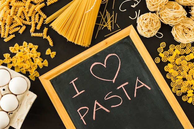I love pasta text written on slate surrounded with uncooked pasta