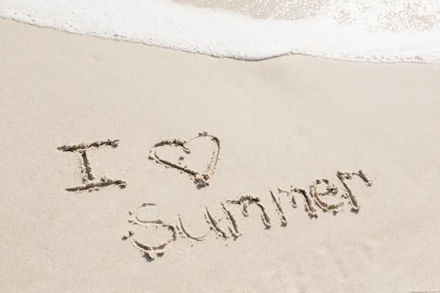 I love summer written on sand