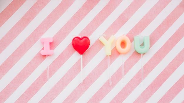 I love you inscription of lollipops on wands