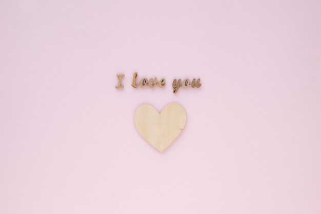 I love you inscription over wooden heart